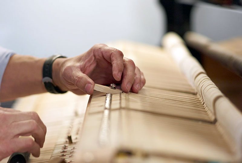 piano tuner checking mallet in Northern Virginia